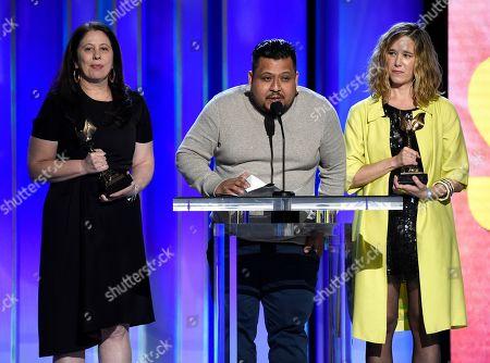 "Carolyn Kaplan, Genoel Ramirez, Lindsay Cordero. Carolyn Kaplan, from left, Genoel Ramirez, and Lindsay Cordero accept the John Cassavetes award for ""En El Septimo Dia"" at the 34th Film Independent Spirit Awards, in Santa Monica, Calif"
