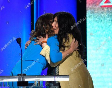 Molly Shannon, Debra Granik. Molly Shannon, left, embraces Debra Granik, the winner of the Bonnie award at the 34th Film Independent Spirit Awards, in Santa Monica, Calif