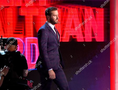 Armie Hammer walks onstage to present the Robert Altman award at the 34th Film Independent Spirit Awards, in Santa Monica, Calif