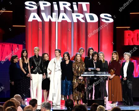 "Gala Moody, Malgorzata Bela, Renee Soutendijk, Stella Savino, Mia, Goth, Tilda Swinton, Angela Winkler, Chloe Grace Moretz, Fabrizia Sacchi, Elena Fokina, Avy Kaufman, Jessica Harper. Avy Kaufman, from left, Dakota Johnson, Tilda Swinton, Jessica Harper, Gala Moody, Angela Winkle, Elena Fokina, Malgorzata Bela, Mia Goth, Stella Savino, Chloe Grace Moretz, Fabrizia Sacchi, and Renee Soutendijk accept the Robert Altman award for ""Suspiria"" at the 34th Film Independent Spirit Awards, in Santa Monica, Calif"