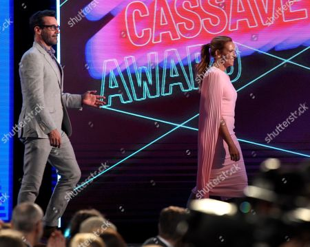 Jon Hamm, Toni Collette. Jon Hamm, left, and Toni Collette appear onstage to present the John Cassavetes award at the 34th Film Independent Spirit Awards, in Santa Monica, Calif