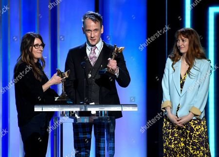 "Nicole Holofcener, Jeff Whitty, Marielle Heller. Nicole Holofcener, left, and Jeff Whitty accept the award for best screenplay for ""Can You Ever Forgive Me?"" with director Marielle Heller, right, at the 34th Film Independent Spirit Awards, in Santa Monica, Calif"