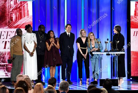 "Barry Jenkins, Kiki Layne, Brian Tyree Henry, Regina King, Jeremy Kleiner, Sara Murphy, Dede Gardner, Adele Romanski. Barry Jenkins, from left, Kiki Layne, Brian Tyree Henry, Regina King, Jeremy Kleiner, Sara Murphy, Dede Gardner and Adele Romanski accept the award for best feature for ""If Beale Street Could Talk"" at the 34th Film Independent Spirit Awards, in Santa Monica, Calif"