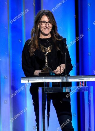 """Nicole Holofcener accepts the award for best screenplay for """"Can You Ever Forgive Me?"""" at the 34th Film Independent Spirit Awards, in Santa Monica, Calif"""
