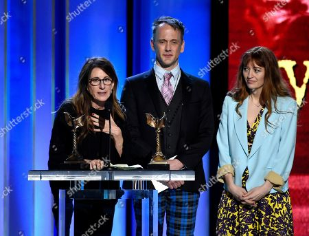 "Nicole Holofcener, Jeff Whitty, Marielle Heller. Nicole Holofcener, left, and Jeff Whitty accept the award for best screenplay for ""Can You Ever Forgive Me?"" with director Marielle Heller, right, looking on at the 34th Film Independent Spirit Awards, in Santa Monica, Calif"