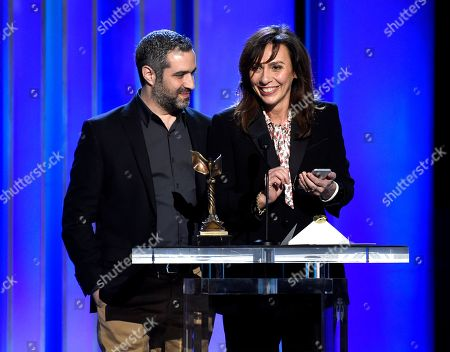 "Stock Picture of Stella Savino, Bradley J. Fischer. Stella Savino, right, accepts the award for best cinematography for ""Suspiria"" on the behalf of Sayombhu Mukdeeprom at the 34th Film Independent Spirit Awards, in Santa Monica, Calif. On left, stands producer Bradley J. Fischer"