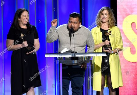 "Carolyn Kaplan, Genoel Ramirez, Lindsay Cordero. Carolyn Kaplan, from left, Genoel Ramirez, Lindsay Cordero accept the John Cassavetes award for ""En El Septimo Dia"" at the 34th Film Independent Spirit Awards, in Santa Monica, Calif"