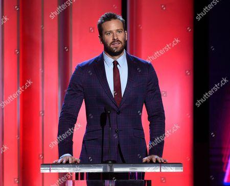 Armie Hammer presents the Robert Altman award at the 34th Film Independent Spirit Awards, in Santa Monica, Calif
