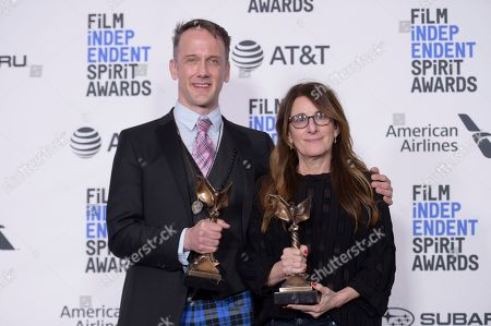 """Jeff Whitty, Nicole Holofcener. Jeff Whitty, left, and Nicole Holofcener pose in the press room with the award for best screenplay for """"Can You Ever Forgive Me?"""" at the 34th Film Independent Spirit Awards, in Santa Monica, Calif"""