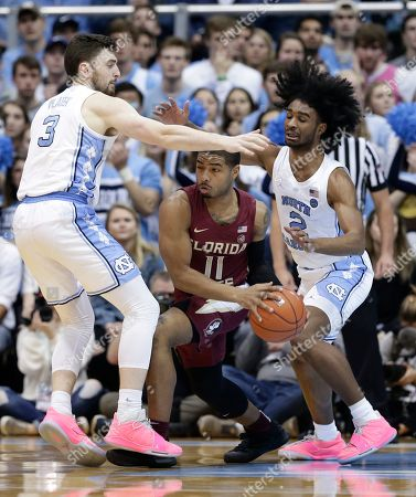 North Carolina's Andrew Platek (3) and Coby White (2) pressure Florida State's David Nichols (11) during the first half of an NCAA college basketball game in Chapel Hill, N.C