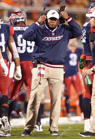 Memphis Express head coach Mike Singletary puts on his headset against the Orlando Apollos during an AAF football game, at Spectrum Stadium in Orlando, Fla