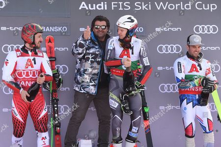 Stock Image of From left, second placed Austria's Marcel Hirscher, first placed Norway's Henrik Kristoffersen and third placed France's Thomas Fanara celebrate on the podium with Italian ski legend Alberto Tomba, second from left, at the end of a men's World Cup giant-slalom, in Bansko, Bulgaria