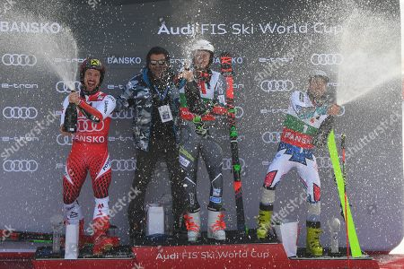 Stock Photo of Former Italian ski racer Alberto Tomba (2-L) celebrates on the podium with first placed Henrik Kristoffersen (C) of Norway, second placed Marcel Hirscher of Austria (L) and third placed Thomas Fanara (R) of France after the Men's Giant Slalom at the FIS Alpine Skiing World Cup in Bansko, Bulgaria 24 February 2019.