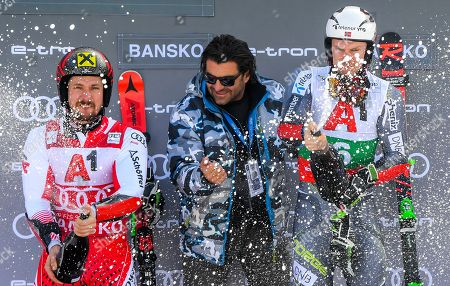 Former Italian ski racer Alberto Tomba (C) celebrates on the podium with first placed Henrik Kristoffersen (R) of Norway and second placed Marcel Hirscher of Austria (L) after the Men's Giant Slalom at the FIS Alpine Skiing World Cup in Bansko, Bulgaria 24 February 2019.