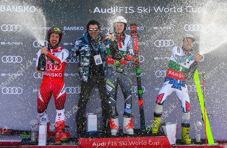 Former Italian ski racer Alberto Tomba (2-L) celebrates on the podium with first placed Henrik Kristoffersen (C) of Norway, second placed Marcel Hirscher of Austria (L) and third placed Thomas Fanara (R) of France after the Men's Giant Slalom at the FIS Alpine Skiing World Cup in Bansko, Bulgaria 24 February 2019.