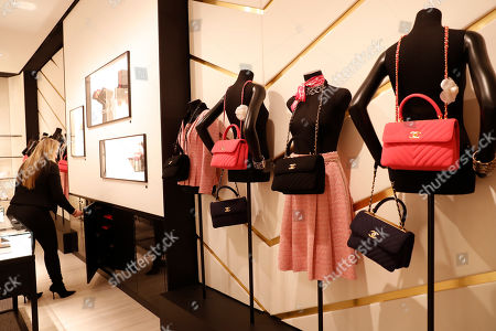 Designer handbags are displayed in Chanel's mini-shop inside Saks Fifth Avenue's flagship midtown Manhattan store, in New York. The store is in the last phase of what Saks president Marc Metrick calls a $250 million redevelopment just as luxury rivals Neiman Marcus and Nordstrom expand into the city. Metrick, 45, hopes the new look will reinvent the department store experience bringing theater to luxury shopping at a time when shoppers can buy their designer handbags online