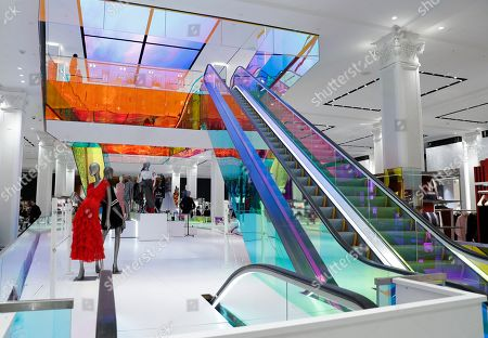 A colorful escalator leads to the second floor inside Saks Fifth Avenue's flagship midtown Manhattan location, in New York. The company is in the last phase of what Saks president Marc Metrick calls a $250 million redevelopment just as luxury rivals Neiman Marcus and Nordstrom expand into the city. Metrick, 45, hopes the new look will reinvent the department store experience, namely bringing theater to luxury shopping at a time when shoppers can buy their designer handbags online
