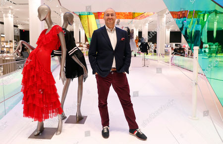 Saks President Marc Metrick poses for a photograph inside the company's flagship Fifth Avenue store, in New York. A company insider, the 45-year-old Metrick aims to reinvent the department store experience to bring theater to luxury shopping at a time when shoppers can buy their designer handbags online