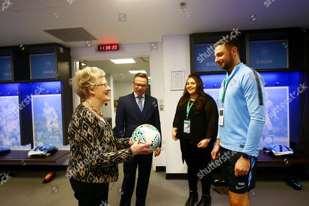 Stock Image of Carabao Cup fans tour around Wembley Stadium with former Manchester City player Paul Dickov