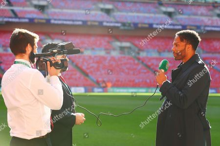 Joleon Lescott is interviewed before the start of the Carabao Cup final at Wembley Stadium