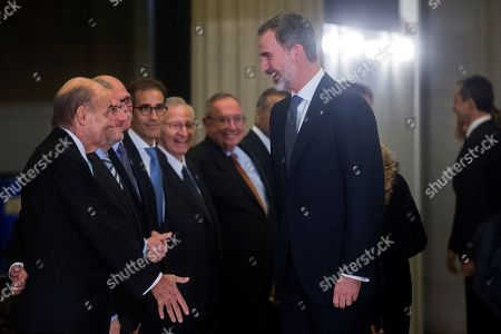 Spain's King Felipe VI (R) greets one of the founders of Spanish Constitution Miquel Roca (L) at the Mobile World Congress 2019 (MWC19), in Barcelona, Spain, 24 February 2019. The latest development in mobile technologies are presented at the MWC19 from 25 to 28 February.