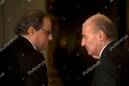 Stock Picture of One of the founders of Spanish Constitution Miquel Roca (R) talks with Catalonian regional President Quim Torra (L) at the Mobile World Congress 2019 (MWC19), in Barcelona, Spain, 24 February 2019. The latest development in mobile technologies are presented at the MWC19 from 25 to 28 February.