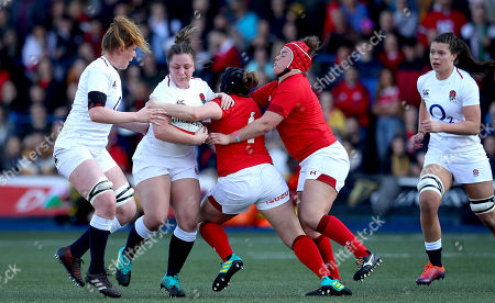 Wales Women vs England Women. Wales' Caryl Thomas and Carys Phillips with Amy Cokayne of England