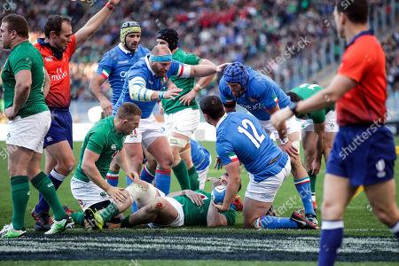 Italy vs Ireland. Italy's Luca Morisi celebrates scoring a try with Dean Budd and Leonardo Ghiraldini