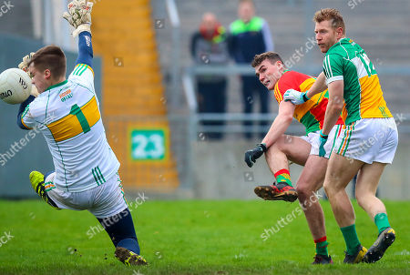 Offaly vs Carlow. Offaly's Paddy Dunican saves a shot from Jordan Morrissey of Carlow