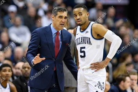 Villanova head coach Jay Wright talks with guard Phil Booth (5) during the first half of an NCAA college basketball game against Georgetown, in Washington