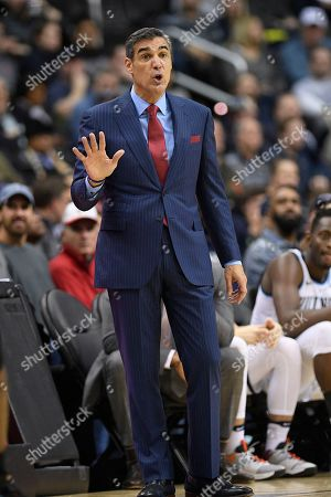 Villanova head coach Jay Wright gestures during the second half of an NCAA college basketball game against Georgetown, in Washington. Georgetown won 85-73