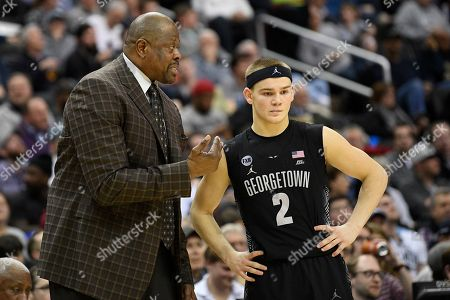 Georgetown head coach Patrick Ewing, left, talks with Georgetown guard Mac McClung (2) during the second half of an NCAA college basketball game against Villanova, in Washington. Georgetown won 85-73