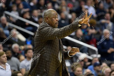 Georgetown head coach Patrick Ewing gestures during the second half of an NCAA college basketball game against Villanova, in Washington. Georgetown won 85-73