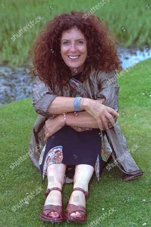 Anita Roddick Founder Of The Body Shop Empire For Feature By Mary Riddell. (also Picture Of Anita With Feminist Display In Entrance To Offices.