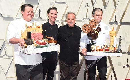 Wolfgang Puck, third from left, arrives at the Oscars, at the Dolby Theatre in Los Angeles