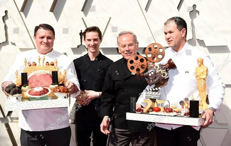 Wolfgang Puck, third from left, arrives with his team and Oscar inspired fare, at the Oscars, at the Dolby Theatre in Los Angeles