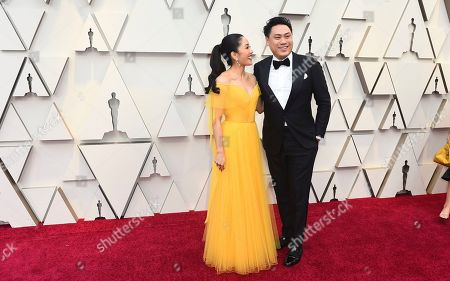 Constance Wu, Jon M. Chu. Constance Wu, left adnd Jon M. Chu arrive at the Oscars, at the Dolby Theatre in Los Angeles