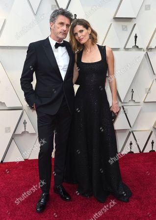 Pawel Pawlikowski, Malgosia Bela. Pawel Pawlikowski, left, and Malgosia Bela arrive at the Oscars, at the Dolby Theatre in Los Angeles