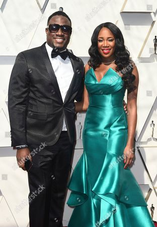 DJ Kiss, DJ M.O.S. DJ Kiss, right, and DJ M.O.S. arrive at the Oscars, at the Dolby Theatre in Los Angeles