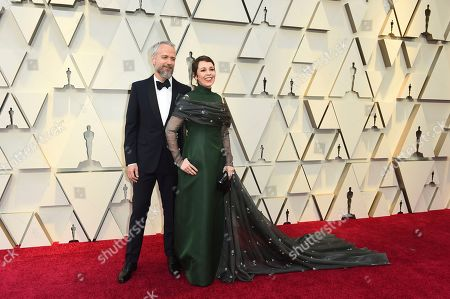 Ed Sinclair, Olivia Colman. Ed Sinclair, left, and Olivia Colman arrive at the Oscars, at the Dolby Theatre in Los Angeles