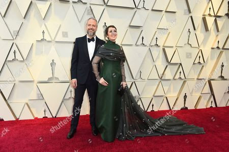 Stock Photo of Ed Sinclair, Olivia Colman. Ed Sinclair, left, and Olivia Colman arrive at the Oscars, at the Dolby Theatre in Los Angeles