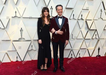 Olivia Grant, Richard E. Grant. Olivia Grant, left, and Richard E. Grant arrive at the Oscars, at the Dolby Theatre in Los Angeles