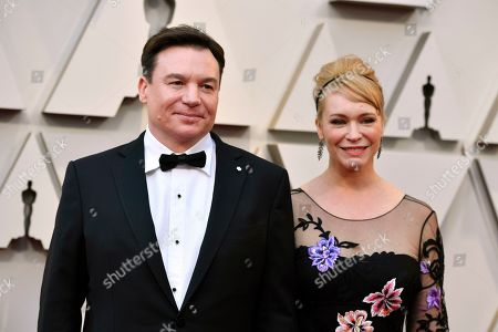 Mike Myers, Kelly Tisdale. Mike Myers, left, and Kelly Tisdale arrive at the Oscars, at the Dolby Theatre in Los Angeles
