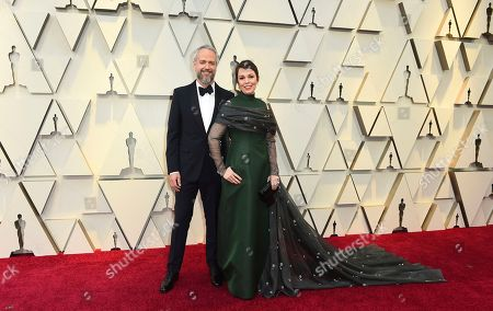 Stock Picture of Ed Sinclair, Olivia Colman. Ed Sinclair, left, and Olivia Colman arrive at the Oscars, at the Dolby Theatre in Los Angeles