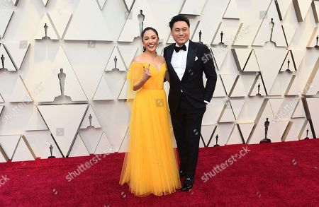 Constance Wu, Jon M. Chu. Constance Wu, left, and Jon M. Chu arrive at the Oscars, at the Dolby Theatre in Los Angeles