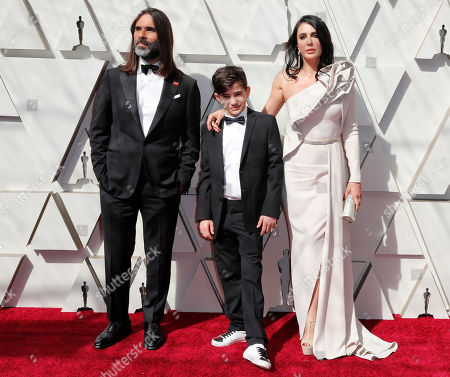 Khaled Mouzanar (L) Zain al-Rafeea (C) and Nadine Labaki (R) arrive for the 91st annual Academy Awards ceremony at the Dolby Theatre in Hollywood, California, USA, 24 February 2019. The Oscars are presented for outstanding individual or collective efforts in 24 categories in filmmaking.