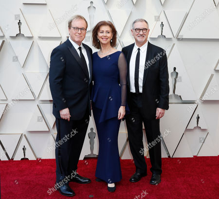 Brad Bird (L), Nicole Paradis Grindle (C), and John Walker arrive for the 91st annual Academy Awards ceremony at the Dolby Theatre in Hollywood, California, USA, 24 February 2019. The Oscars are presented for outstanding individual or collective efforts in 24 categories in filmmaking.