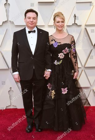 Kelly Tisdale, Mike Myers. Mike Myers, left, and Kelly Tisdale arrive at the Oscars, at the Dolby Theatre in Los Angeles