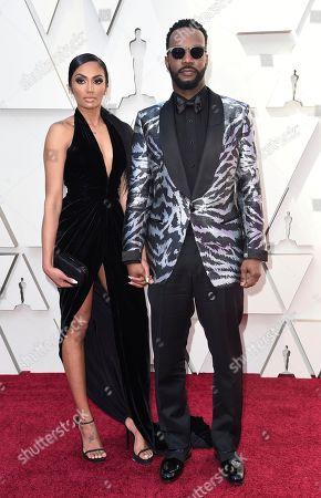 Regina Perera, Juicy J. Regina Perera, left, and Juicy J arrive at the Oscars, at the Dolby Theatre in Los Angeles
