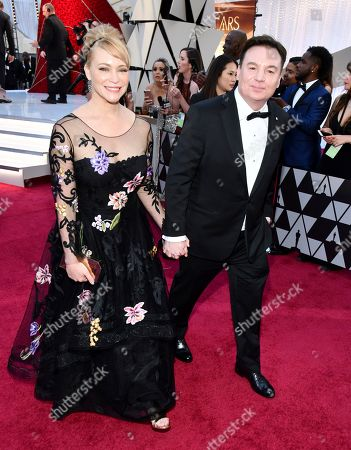 Mike Myers,Kelly Tisdale. Kelly Tisdale, left, and Mike Myers arrive at the Oscars, at the Dolby Theatre in Los Angeles